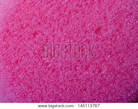 Pink pore pumice stone as texture background
