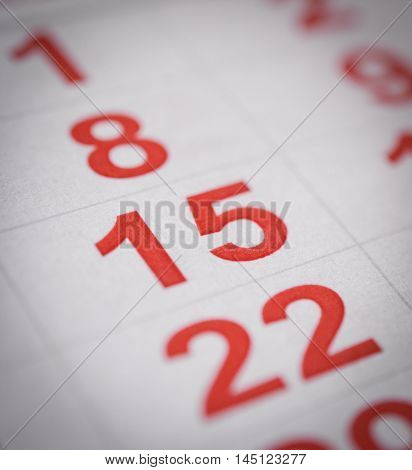 close up red white calendar fifteenth number