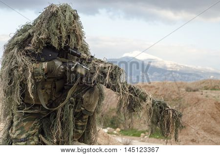 Ghillie suit sniper scope and rifle camouflage poster