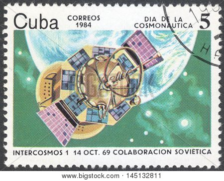 MOSCOW RUSSIA - CIRCA AUGUST 2016: a stamp printed in CUBA shows Intercosmos 1 (1969) the series