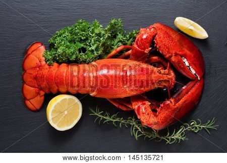 Boiled lobster on black slate plate