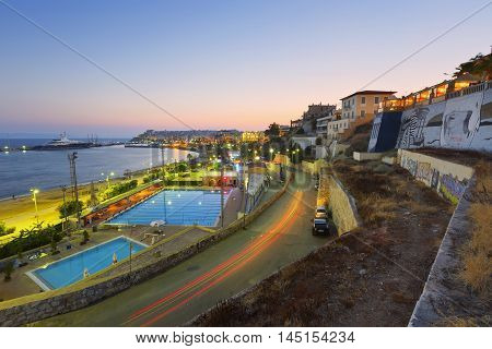 ATHENS, GREECE - AUGUST 30, 2016: View of the municipal swimming pool in Piraeus and mouth of Zea marina, Athens on August 30, 2016.