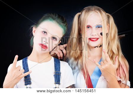 Young Teenager Girls in Carnival Costume on dark background