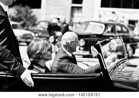 Podol, Ukraine - May 19, 2016: Elegant People On Sunglasses With Cigarette Stay  On Maybach Cabriole