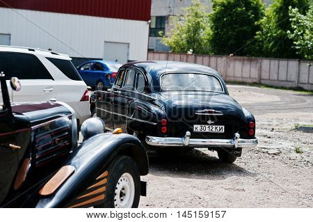 Podol, Ukraine - May 19, 2016: Back View Of Goes On Road Gaz-12 Zim, Luxury Soviet Limousine