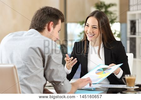 Businesspeople smiling coworking commenting and showing growth graphic and taking a business conversation in an office interior poster