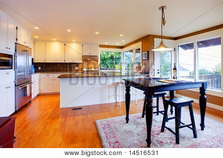 Luxury White Kitchen  And Black Breakfast Table