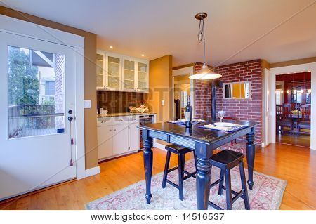 Luxury White Kitchen With Beautiful Stove And Black Breakfast Table