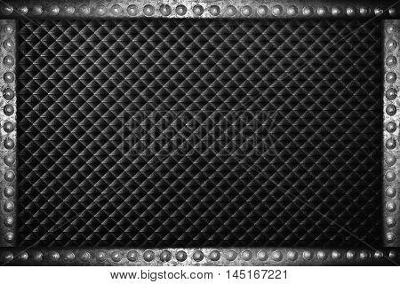 black plastic background with metal rivets frame