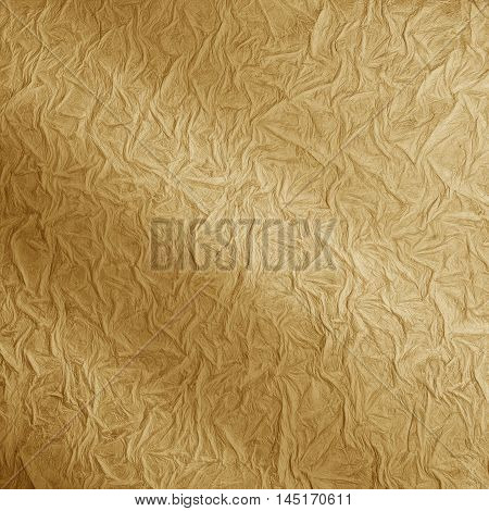 Ragged surface texture. Golden color. Warm background
