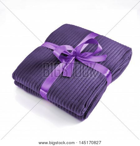Blanket tied with a lilac bow against white background