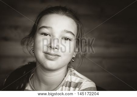 9-10 years old teen girl. Black and white photo
