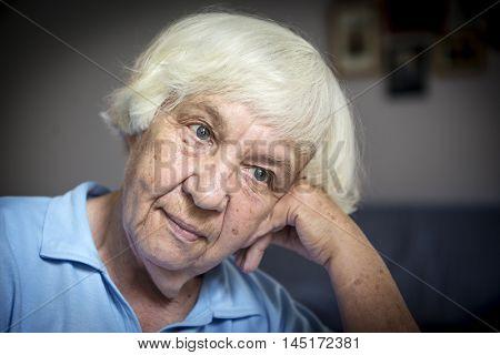 Portrait of  Melancholic  elderly woman.