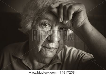 Portrait of  Melancholic  elderly woman. Black and white photo