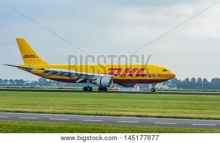 Polderbaan Schiphol Airport the Netherlands - August 20 2016: DHL cargo aircraft landing