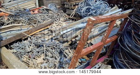 salvage metal, hook and eyes, wires, parts, frame bars, wooden boxes, lumber pieces,  Songkhla, Thailand