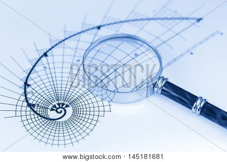 magnifying glass & architectural drawing of the golden section