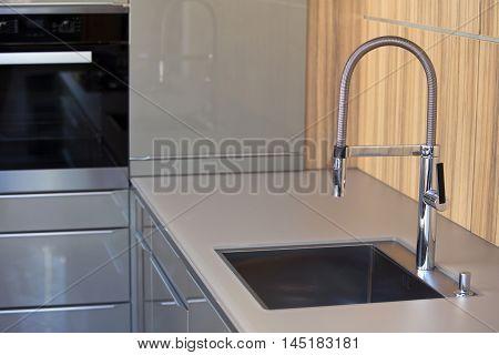 modern  grey kitchen with stainless steel sink