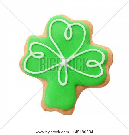 Tasty cookie in clover shape, isolated on white. Saint Patrics Day concept