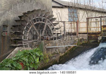 Wheel water mill in Reana del Rojale, Friuli, Italy poster