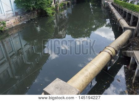 Pipe with wastewater in urban wastewater in bangkok Thailand.