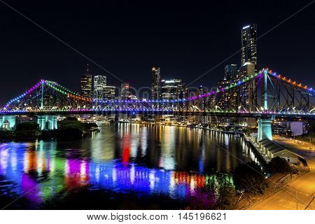 BRISBANE, AUSTRALIA - AUGUST 28 2016: Story Bridge by Night -  multi-coloured lights  (Blue, Pink, Green, Orange, Purple) for Brisbane Writers Festival.