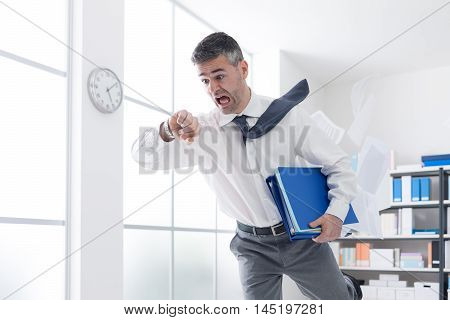 Businessman In A Hurry Checking Time