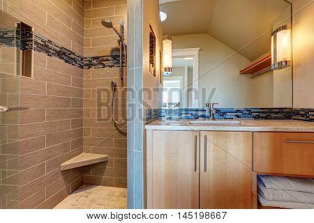 Modern Mocha Bathroom Interior Design With Tile Wall Trim.