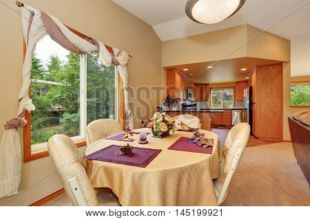 Soft Beige Dining Room Interior With Nicely Decorated Table