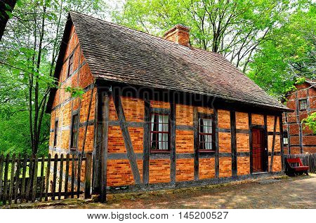 Old Salem North Carolina - April 21 2016: Fachwerk half-timbered and brick1765 Fourth House built by Moravian settlers on Main Street *
