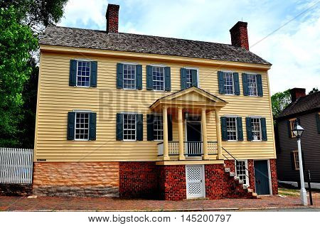 Old Salem North Carolina - April 21 2016: Expansive late 18th century woodframe colonial home with brick basement and chimneys on Main Street *