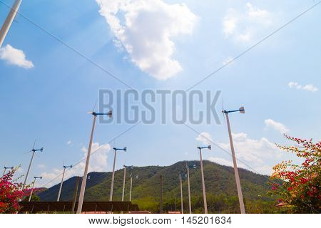 Wind Turbine Blue Sky Background Agianst Mountain
