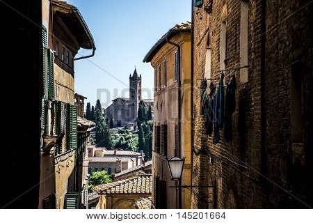 Look through the alleys of Siena in Italy