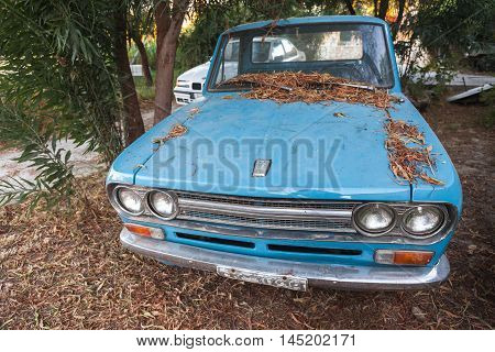 Front View Of Old Blue Datsun 1300 Pickup