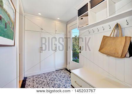White Hallway Interior.  Storage Cabinet With Hangers