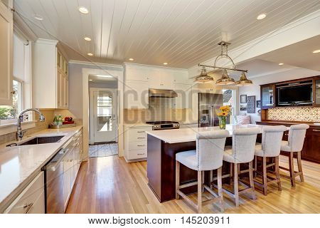 White Interior Of Kitchen Room With Large Kitchen Island.