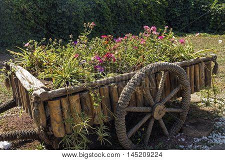 YEREVAN, ARMENIA - AUGUST 25, 2016:Beautiful original flowerbed outside in the form of an old cart in Yerevan,Armenia.