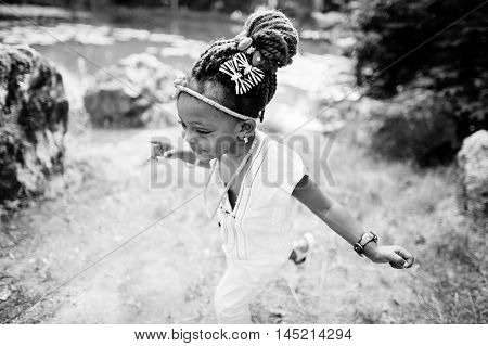 Close up portrait of african baby girl walking at park