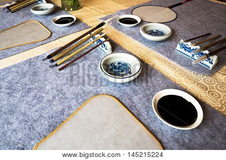chinese calligraphy tools on table