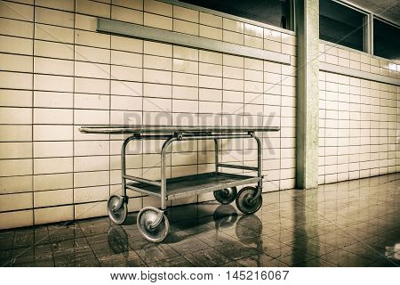 Old vintage metal stretcher in horror hospital