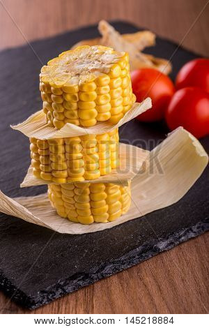 Stack Of Sweet Corn Portions On Slate Plate