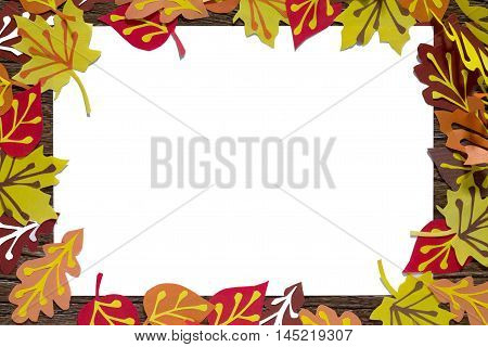 Autumn Colored Paper Leaves On A Wooden Board, Copy Space. A Sheet Of Paper Craft For Children. Chil