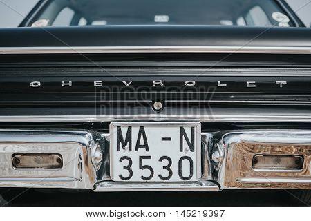 MALAGA, SPAIN - JULY 30, 2016: 1965 Chevrolet Malibu Cheville back view detail, parked in Malaga aerodrome, Spain.