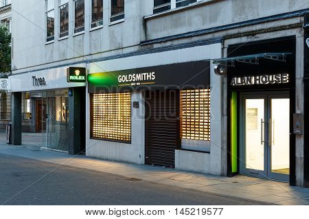 NOTTINGHAM ENGLAND - AUGUST 30: Frontage of the Goldsmiths jewellery store at night on Clumber Street. In Nottingham England. On 30th August 2016.
