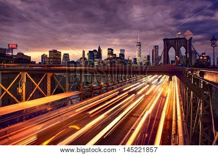 Night car traffic on Brooklyn Bridge in New York City