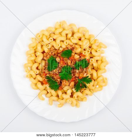 A plate of pasta with Bolognese sauce top view. Traditional Italian food