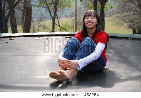 Pretty Girl On Trampoline