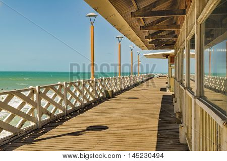 Perspective view of wood breakwater walkway at beach in Fortaleza Brazil
