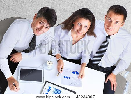 Businesspeople Having Meeting Around Table In Modern Office