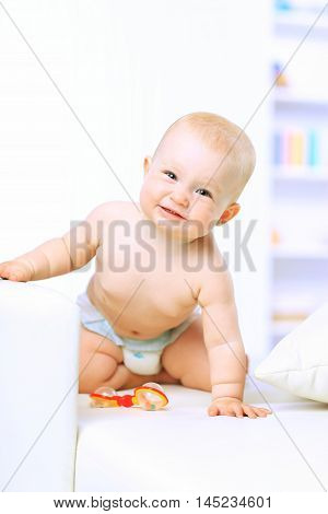 bright portrait of adorable baby  in the nursery